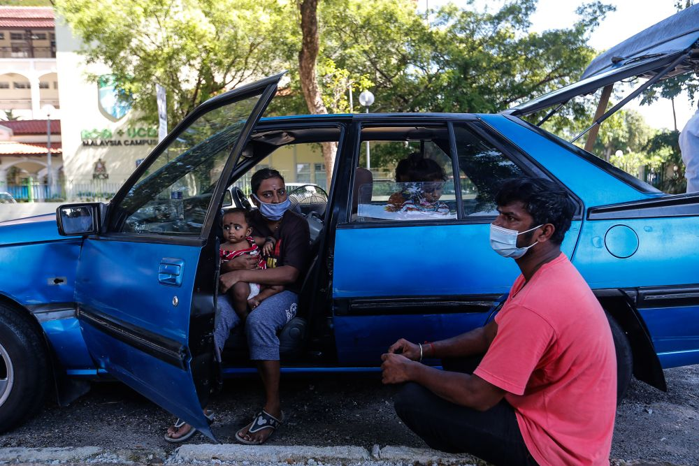 Family of five in Penang appeals for public housing after living in car for eight months | Malaysia | Malay Mail